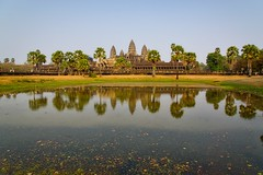 Angkor Wat with reflections in the pond in the late afternoon near Siem Reap, Cambodia (UweBKK ( 77 on )) Tags: trees lake history water reflections religious temple pond ancient ruins asia cambodia kambodscha afternoon khmer buddha sony faith religion buddhism angkorwat siem reap historical late southeast alpha dslr siemreap angkor wat hindu hinduism archeology 77 slt archeological