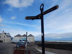 Signpost by Johnshave harbour (Dunnock_D) Tags: road uk blue houses sea sky clouds grey scotland unitedkingdom britain piers northsea signpost slipway habour johnshaven
