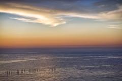 Poles of the ocean (M. Nasr88) Tags: ocean blue sunset sea sky beach nature water clouds landscape outdoors nikon waterfront uae peaceful serene nikondigital manualfocus unitedarabemirates tranquil fairmont goldenhour ajman naturephotography hotal nikonphotography nikond5300