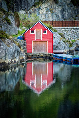 Boat house, Bergen, Norway (Paulius Bruzdeilynas) Tags: red reflection water norway evening norge sony calm redhouse norwegian fjord bergen boathouse sonyalpha sonya7ii