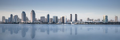 San Diego Panorama (David Colombo Photography) Tags: california longexposure blue sunset panorama reflection water architecture buildings landscape bay downtown skyscrapers sandiego outdoor panoramic