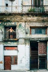 Old Havana (Simone Della Fornace) Tags: street old city travel man building tourism window architecture 35mm person sony famous voigtlander havana streetphotography landmark historic streetphoto derelict urbex