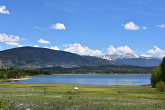 Colorado Rockies (Ron,Ron,Ron) Tags: sky cloud mountain lake green water sunshine colorado scenic roadtrip shade lakeshore mountainside snowpeaks
