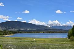 Colorado Rockies (Ron,Ron,Ron) Tags: sky cloud mountain lake green water sunshine colorado scenic roadtrip shade lakeshore mountainside snowpeaks