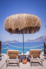 Umbrella day (aleksey_kondratiev) Tags: turkey fethiye oludeniz mediterranean sea water blue wave waves seashore rocks sky mountain beach umbrella