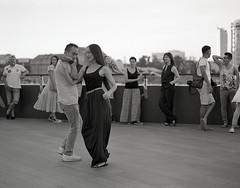 Street dancers (sinkalyagas) Tags: city street dancers man girl openair outdoor film filmnotdead mamiya rz67 mediumformat ilford hp5