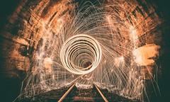 Steel wool (hispan.hun) Tags: steel steelwool light fire tunnel train rail hispansphotoblog wideangle night spiral circle vortex sonyphotography samyang