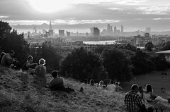 Sunset in Greenwich Park (Spannarama) Tags: blackandwhite greenwichpark london uk sunshine flare lowsun park blackheath people sitting view viewpoint hill backlit trees