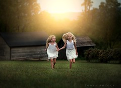 Frolic (Sonya Adcock Photography) Tags: girl child kid photography childphotography light evening glow warm family painterly portrait ray poetry poetic story nikon nikond700 nikkor nikkor105mmdc childhood fineart fineartphotography painting art sonyaadcockphotography children barn barns run running play fun frolic vineyard dresses