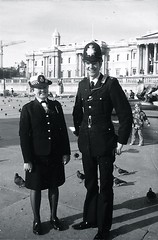 Metropolitan Police, Cannon Row Police Station (Alpha Delta) Constables On Duty Trafalgar Square, circa 1978. Woman Police Constable Rosie Hoskins  and Police Constable Neil Watson. (sgterniebilko) Tags: uk london westminster westminsterabbey ad trafalgarsquare police buckinghampalace demonstrations policestation whitehall royalty sw1 royalfamily scotlandyard metropolitanpolice marlboroughhouse alphadelta adivision cannonrow aorwhitehalldivision