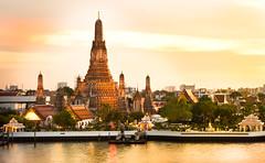 Wat Arun (kumpolstock) Tags: light sunset shadow river dark thailand temple ancient colorful bangkok buddha religion vivid spirituality ruined thaiculture capitalcities warmlighttone