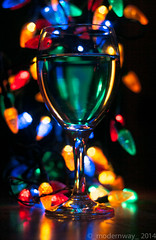 Christmas Cheer. (_modernway_) Tags: lighting christmas blue light red green water glass silhouette yellow dark lights lowlight colorful wine champagne newyear celebration celebrations string colourful wineglass fairylights merrychristmas christmastime happynewyear glassontable