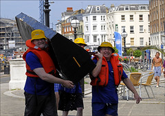 100627.094. Carry That Weight. (actionsnaps) Tags: men sunglasses kent competition effort strength thebay margate lifejacket lifepreserver carrying teamwork pfd maewest sunhat thanet stamina workingtogether physicalactivity personalflotationdevice homemaderaft teamevent carrythatweight seasidefun bouyancyaid competitiveactivity hardgoing lifesavervest toughgoing aquaticactivity pubcustomers margateraftrace margatemainsands raftcrew themadhousebar brokenraft