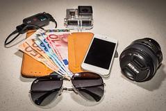 Travel kit (www.higbyphotography.com) Tags: travel photography equipment accessories mystuff euros camerastrap raybans nikonlens gopro travelkit photographerequipment