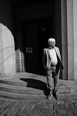 Portrait of an elderly man (HKI DRFTR) Tags: shadow portrait people blackandwhite streets monochrome sunshine contrast helsinki europe place time noiretblanc candid streetphotography humans socialdocumentary emptyspace deadspace