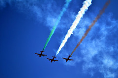 Coordinated flying during Aero India air show (rkunni) Tags: blue red sky fly wings fighter lift aircraft smoke flight adventure formation airshow trail maneuver
