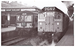 Diesels at Derby Midland Station. (ManOfYorkshire) Tags: class105 class24 class25 diesel mutiple unit britishrail britishrailways railway trains derby midland station green blue steam heating crewe b1 2g97 blackandwhite monochrome old photograph 1960s cravens