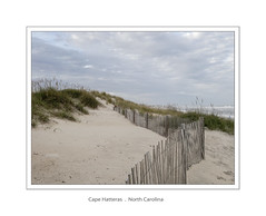 Cape Hatteras (Maryse Tremblay) Tags: ocean blue sky seascape beach water clouds fence sand outdoor paysage seagrass capehatteras marysetremblay
