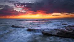 Sky Fire (David Colombo Photography) Tags: ocean blue sunset red orange seascape clouds landscape nikon rocks waves purple pacific outdoor vibrant pacificocean reef hightide d800 blazing windandsea davidcolombo davidcolombophotography