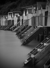 Stepping out... (Collingwood505) Tags: blackwhite blackandwhite monochrome water silky torquay devon beach beachhuts nikon d750 10stopfilter longexposure steps wood afterdark empty