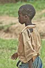 best shirt he owns (Pejasar) Tags: boy child student alhambra ghana westafrica africa shirt torn kokombapeoplegroup tribe