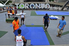 Tennis Setup (Pedestrian Photographer) Tags: dsc5933b dsc5933 toronto sign tennis setup nathan phillips square workers tiles blue green july 2016 summer canada ontario ribbet