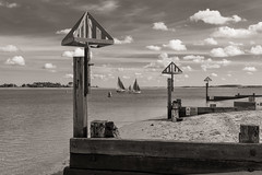 Little fluffy clouds... (AJFpicturestore) Tags: littlefluffyclouds groynes groynemarkers boats sail wellsnextthesea norfolk beach monochrome blackwhite theorb