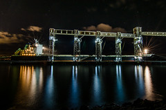 The Ri Guan Feng Fills Up (Brian Xavier) Tags: nightphotography stars photography industrial nopeople timeexposure brightlights pugetsound lightrays citynight starbursts reflectionsinwater internationaltrade seatrade starsinthesky photographicarts industrialnightphotography bxavier bxphoto brianxavierphotography brianxavier bxfoto bxfotocom amgenport amgensilos chineseboatfillswithgrain riguanfeng boatfillswithgrain businessinthepugetsound internationalgraintrade nightphotogallery