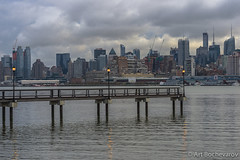 A Manhattan skyline as seen from Hoboken on early morning Nov 27, 2014. (abochevarov) Tags: nyc newyorkcity morning newyork ferry skyline clouds dawn view manhattan earlymorning manhattanskyline lamps hoboken nikondf