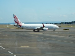 Virgin jet taxiing towards the runway as it leaves the terminal behind. (Bob Green 52) Tags: tarmac airplane aircraft wing engine australia geelong avalonairport