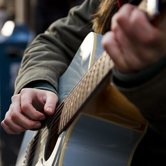 Baby Blues (Leanne Boulton) Tags: life lighting street city uk blue light shadow people urban musician music sunlight abstract color colour detail texture girl closeup female canon square photography 50mm scotland living hands aperture focus shadows natural humanity bokeh guitar outdoor glasgow candid fingers young streetphotography scene human shade crop 7d instrument format busker performer depth tone fragment candidstreetphotography