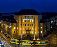 Hochtiefhaus Essen (Thomas Kriehn Photography) Tags: city blue yellow architecture train germany deutschland essen tram bluesky olympus bleu gelb architektur nrw bluehour 365 blau ruhrgebiet omd thebluehour ruhrpott blauestunde project365 365days em5 ruhrvalley 365daysproject strasenbahn 365tage hochtiefhaus 3652015