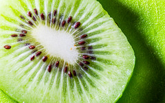 (212/365) KIWI! (Chexjc) Tags: macro green up fruit canon project photography eos close background board 100mm cutting 365 usm kiwi f28 650d t4i