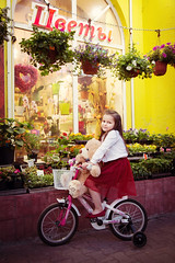 IMG_7387 (D-Ulia) Tags: city flowers sunset sun streets girl smile kids backlight fun spring twilight little blossom bokeh walk backlit walkaround bycicle