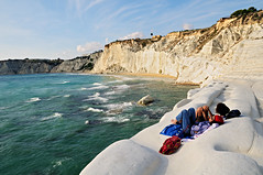 Two young women relaxing on the beautiful white marl cliff of the Scala dei Turchi - Sicily (PascalBo) Tags: sea italy mer seascape beach nature rock landscape outdoors seaside nikon europe italia outdoor shore sicily paysage plage italie sicilia d300 sicile realmonte scaladeiturchi pascalboegli