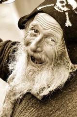 Street entertainer in Manchester, UK. (adamsackfield) Tags: blackandwhite man manchester 50mm streetphotography wrinkles d7000