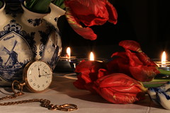 All the time in the world (alideniese) Tags: lighting flowers blue red stilllife white closeup blackbackground tulips clogs vase candlelight tabletop pocketwatch delftware parrottulips tulipvase