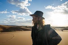 NO TREES IN THE DESERT (DanielO'Donnell & AbiPonceHardy) Tags: blue sky orange sun man sahara hat amazing sand desert dune morocco moroc colonelmustard madamedijon