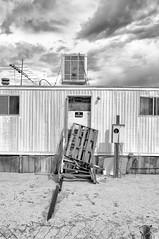 Abandoned Desert Trailer III (autobahn66.com) Tags: california blackandwhite abandoned clouds desert decay joshuatree dramatic americana trailer caravan antenna monochome