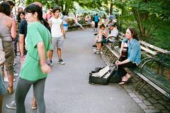 41880030 (alexdotbarber) Tags: 115 35mm c41 centralpark kodakportra160at80 nyc newyorkcity strawberryfields vigtlanderbessar3a voigtlandernokton40mmf14 analog bokeh busker f2 film guitarist musician rangefinder