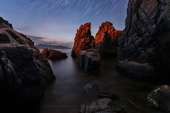 The Red Piggy Cave (Jackie Tran Anh) Tags: milkyway stars startrails rocks hill mountain sunrise clouds sky nightocean sea seascape longexposure