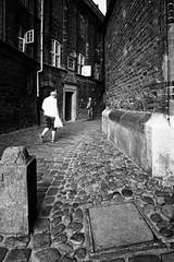 Alley meeting (JarHTC) Tags: fujifilm xe2 samyang 12mm bw monochrome alley street town