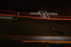 jesus saves ll (pbo31) Tags: livermore eastbay alamedacounty highway 580 dark black color ramp exit lightstream roadway motion traffic october 2016 boury pbo31 nikion d810 altamontpass sign jesus saves country greenville overpass giant cross