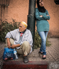 LADY IN GREEN AND HER FATHER (Maythem Ridha) Tags: travel arabic morocco marrakesh immigrant migrant geolocation geocity exif:isospeed=800 exif:make=sony geocountry exif:focallength=18mm middleeaststreet camera:make=sony geostate exif:aperture=35 exif:lens=e1855mmf3556oss camera:model=nex7 exif:model=nex7 maythemridha