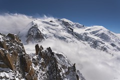 Le Mont-Blanc sort des nuages ! Poping out from the clouds the King Mont-Blanc ! (Claude Jenkins) Tags: snow storm france mountains ice clouds vent nikon rocks frost d750 neige nuages chamonix 74 montblanc glace hautesavoie