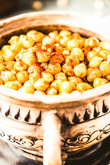 baked chickpeas with spices on rustic background, close-up (harmonyandtaste) Tags: food brown hot cooking kitchen yellow dinner rural wooden vegan healthy natural eating background indian spice rustic tasty bowl curry vegetable delicious meal brunch appetizer spicy lime arabian oriental grilled fried paprika seasoning baked roasted smoked scattered chickpeas nutritious chickpea salted