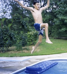 Jeremy jumps (Pejasar) Tags: boy party oklahoma water pool swimming fun jeremy leap sandsprings