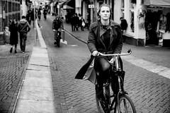 Street contact (angheloflores) Tags: street city light portrait people urban blackandwhite woman eye beautiful amsterdam bike candid explore 55mm bokhe