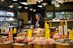 Nishiki Market, Kyoto (veronicajwilliams photography) Tags: veronicajwilliamsphotography veronicajwilliams kyoto kyotoculture japan japanese japaneseculture japanmarket travelphotography travel travelling traveling canon5dmarkii canon2470mmf28l canon2470mm canon2470 bored retail woman shop sales food