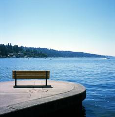 Day 161 - Sitting On The Dock of the Bay (Great Beyond) Tags: mamiyac330professional mamiyasekor 80mm fujichromeprovia100f mamiyaflex tlr twinlensreflex mediumformat 66tlr 120film squareformat bluedot fujiprovia100f fujifilm slide slides slidefilm colorreversal e6 365 project365 2016 may2016 may water bench bay dock park lake lakewashington